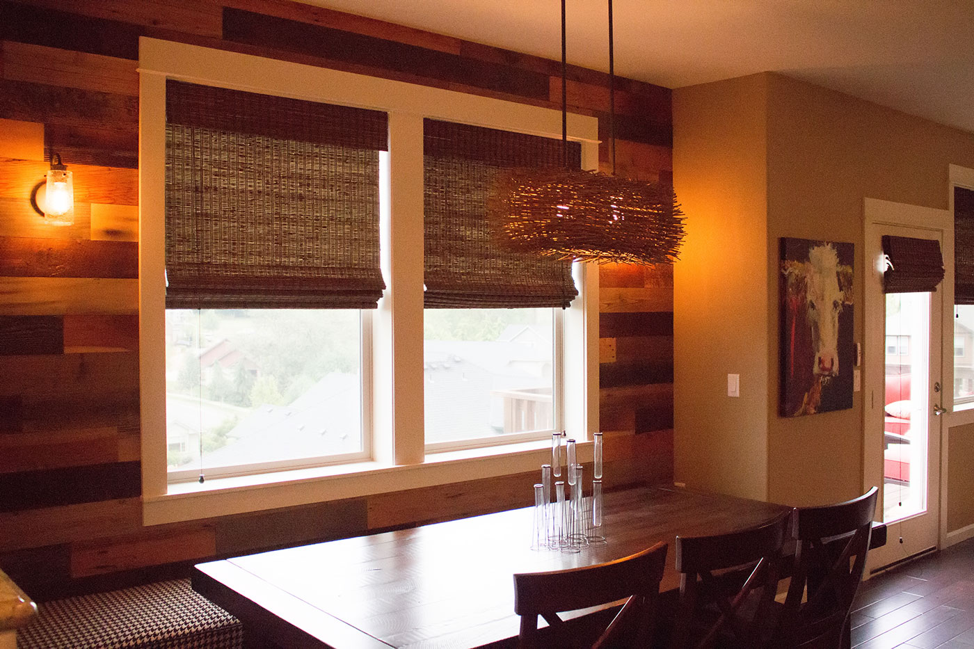Custom lighting and barnwood detail in modern kitchen design. Rebecca Olsen Designs, Oregon