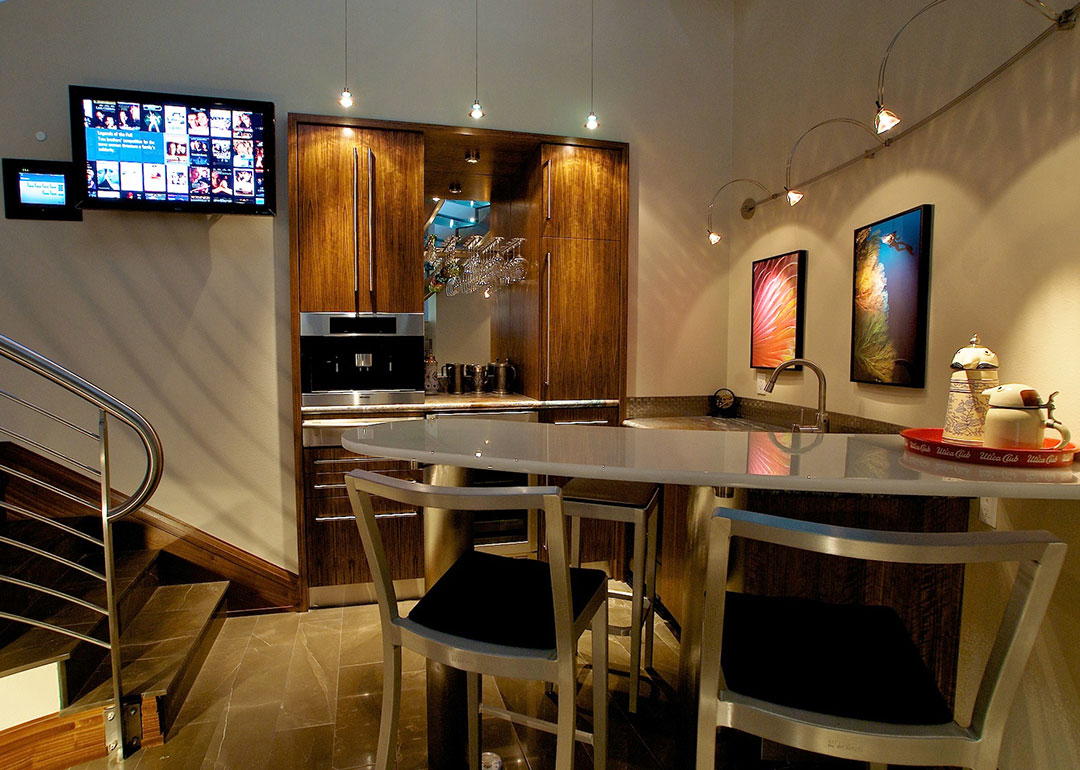 A modern bar design custom made to fit underneath an open spiral staircase. Rebecca Olsen Designs, Salem, OR